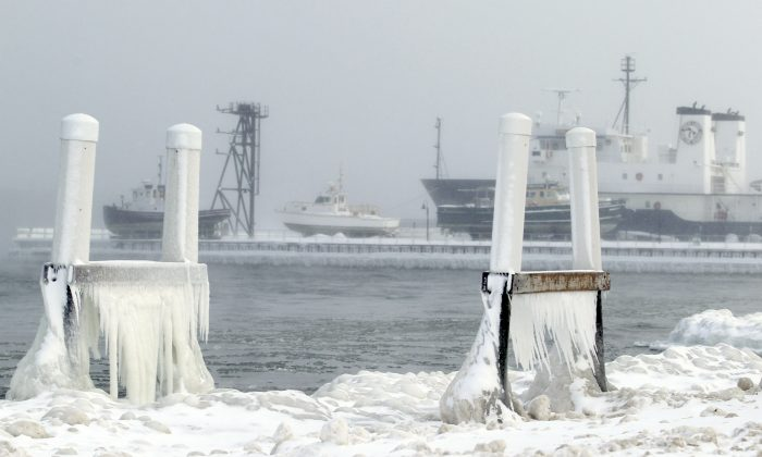 In this Jan. 7, 2014 photo ice forms on parts of a dock on West Grand Traverse Bay near the Great Lakes Maritime Academy in Traverse City, Mich. (AP Photo/ Traverse City Record-Eagle, Keith King, File) MANDATORY CREDIT