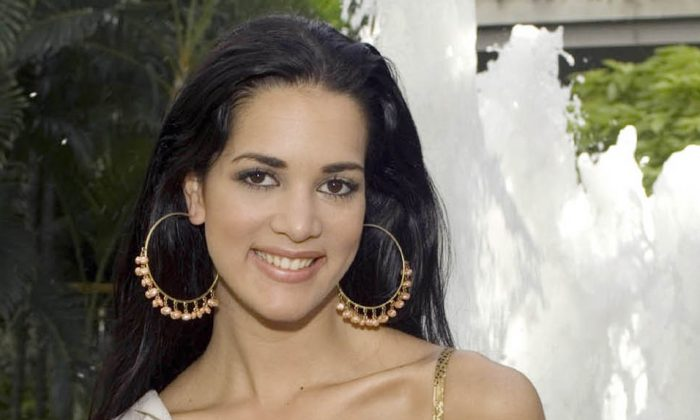 This May 23, 2005 file photo released by Miss Universe shows Monica Spear, Miss Venezuela 2005, posing for a portrait ahead of the Miss Universe competition in Bangkok, Thailand. Venezuelan authorities say the soap-opera actress and former Miss Venezuela and her husband were shot and killed resisting a robbery after their car broke down. Prosecutors said in a statement that Monica Spear and Henry Thomas Berry were slain late Monday, Jan. 6, 2014 near Puerto Cabello, Venezuela's main port. (AP Photo/Miss Universe Darren Decker, File)