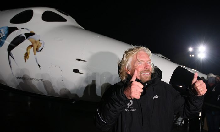 Sir Richard Branson unveils Virgin Galactic's SpaceShipTwo at the Mojave Spaceport in California on Dec. 7, 2009. The British company is not accepting applications for its space flights from Chinese nationals to prevent spying. (David McNew/Getty Images)