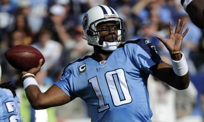 Vince Young, who is broke, in a 2010 NFL game. (AP Photo/Frederick Breedon)