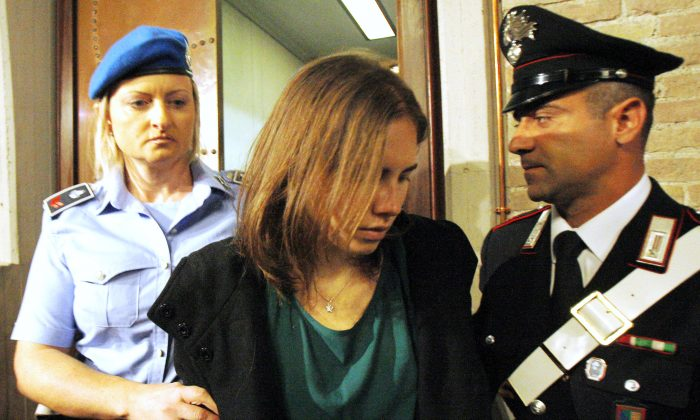 Amanda Knox in a 2011 file photo enters an Italian appeals court in what turned out to be a successful appeal of her guilty sentence. However, another court is currently re-examining the case. (AP Photo/Antonio Calanni)