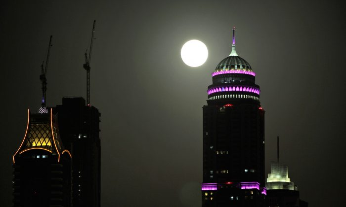 A super moon rises in Dubai, United Arab Emirates in this June 2013 file photo. (AP Photo/Kamran Jebreili)