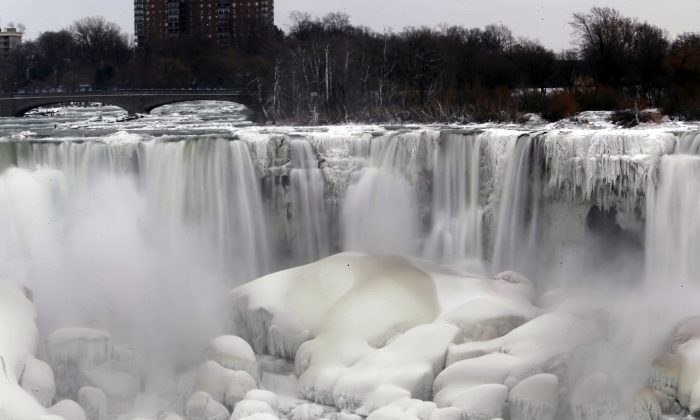 The U.S. side of Niagara Falls is thawing after being frozen solid from the recent polar vortex early January, in Niagara Falls, N.Y., Jan. 10, 2014. New York state is promoting tourists sites outside of New York City like the falls. (Nick LoVerde/AP)