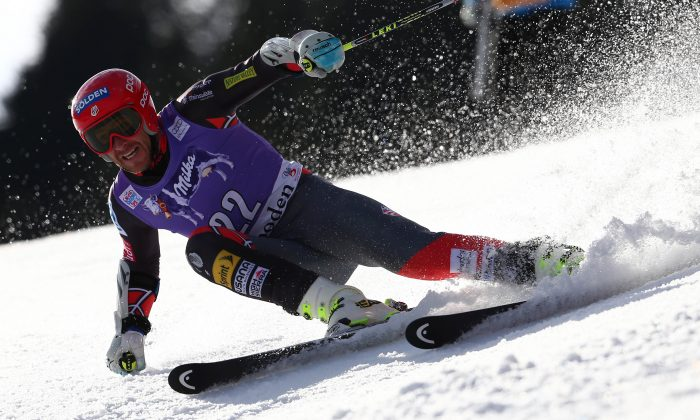 Bode Miller, of the US, competes during the first run of an alpine ski, men's World Cup giant slalom in Adelboden, Switzerland, Saturday, Jan. 11, 2014. (AP Photo/Giovanni Auletta)