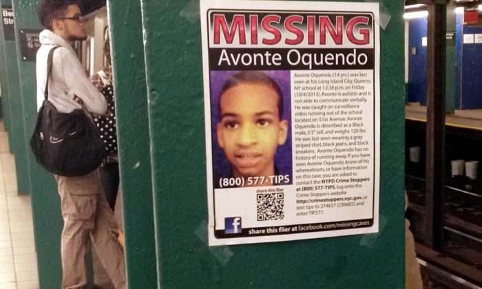 In this Oct. 21, 2013 file photo, a missing poster asking for help in finding Avonte Oquendo is displayed at a subway station in the Brooklyn borough of New York. Oquendo, 14, who is autistic, was last seen on Oct. 4 walking out of his Queens school. (AP Photo/Barbara Woike)