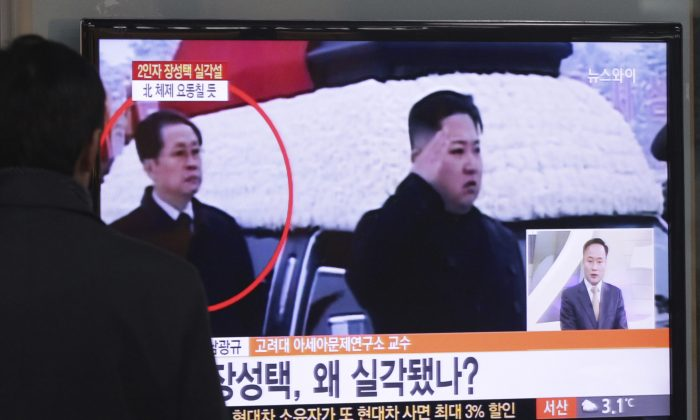 A file photo shows a man in South Korea watching a news program that shows Jang Song Thaek, who was executed by North Korean dictator Kim Jong Un. Now, Thaek's whole family has been executed as well, it has been revealed. (AP Photo/Ahn Young-joon)