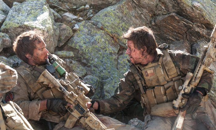 "This file photo released by Universal Pictures shows Taylor Kitsch, left, as Michael Murphy and Mark Wahlberg as Marcus Luttrell in a scene from the film, ""Lone Survivor."" The Navy SEAL drama earned $37.8 million in its first weekend of wide release. (AP Photo/Universal Pictures, Gregory R. Peters, File)"