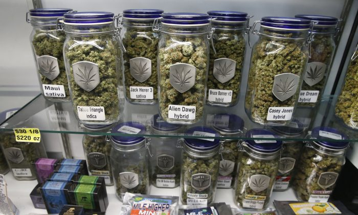 Marijuana and cannabis-infused products are displayed for sale at Medicine Man marijuana dispensary, which is to open as a recreational retail outlet in Denver, Colorado, in 2014. (AP Photo/Brennan Linsley)