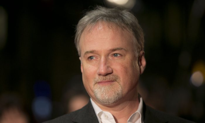 House of Cards director David Fincher arrives on the red carpet for the Netflix UK Premiere of the show at a Leicester Square cinema in London on Jan. 17, 2013. (Joel Ryan/Invision/AP)