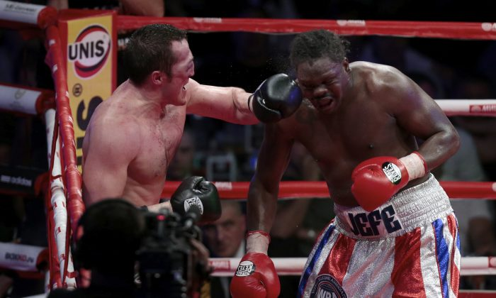 Denis Lebedev, of Russia, left, and Guillermo Jones, of Panama, fight during their WBA cruiserweght world championship title bout, in Moscow, Russia, on Friday, May 17, 2013. Jones knocked out Lebedev in the 11th round. (AP Photo/Ivan Sekretarev)