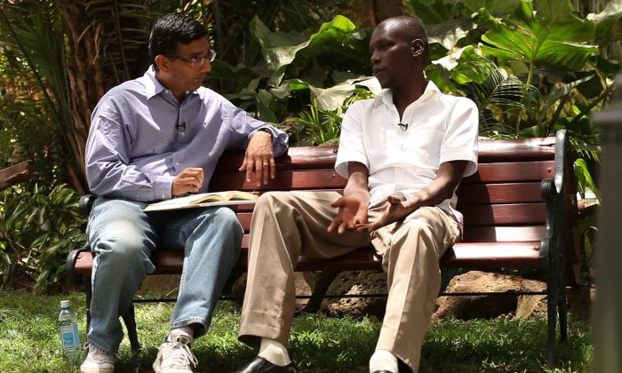 "Dinesh D'Souza interviewing George Obama in ""2016: Obama's America."" (AP Photo/Rocky Mountain Pictures)"
