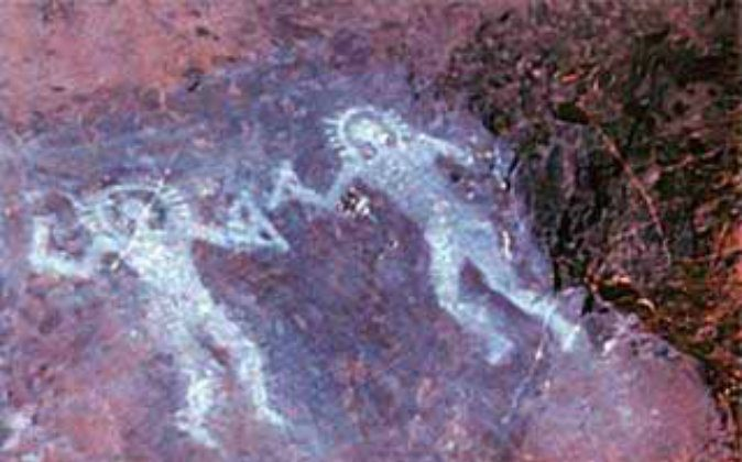 Cave paintings as old as 10,000 years in Valcamonica, Italy, show people wearing what some have said are space suits. (Wikimedia Commons)