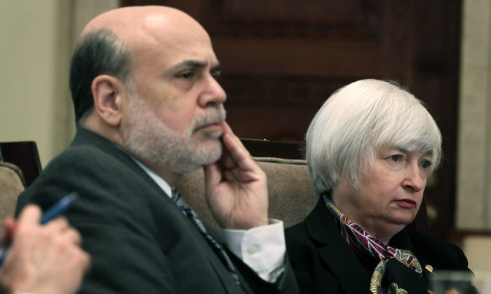 Federal Reserve Board Chairman Ben Bernanke (L) and Janet Yellen (R), vice chair and President Obama's nominee to succeed Bernanke, listen during a meeting of the Board of Governors of the Federal Reserve System in Washington, D.C., Dec. 10, 2013. (Alex Wong/Getty Images)