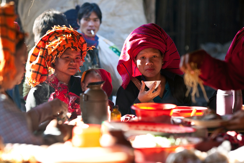 Women of the Pa-O tribe enjoy the local Htamanu Festival in Sanghar Village, Shan State, Burma, on Jan. 15, 2011. Burma and India are both diverse states that have experienced decades-long clashes between various ethnicities, while striving toward democracy. (Shutterstock*)