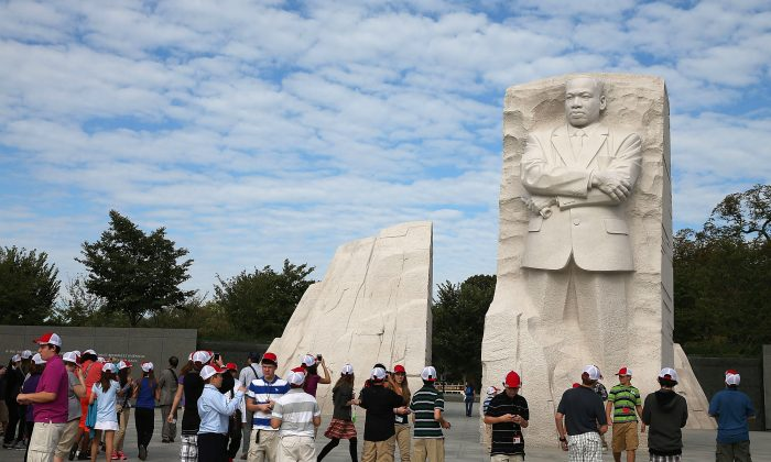 Tourists gather at the Martin Luther King Memorial one day after a bipartisan bill was passed by the House and the Senate to reopen the government and raise the debt limit, on October 17, 2013 in Washington, DC. (Mark Wilson/Getty Images)