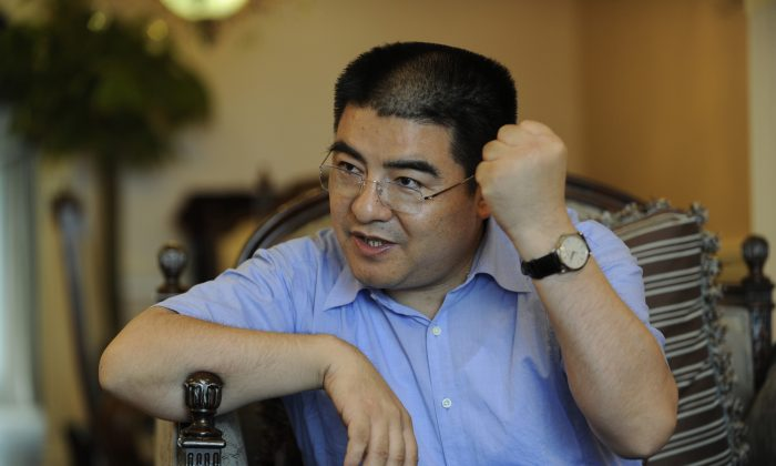 Chen Guangbiao gesticulates in an interview on Sept. 16, 2010 in Beijing. (Peter Parks/AFP/Getty Images)