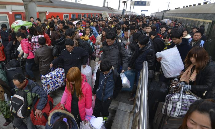 Passengers crowd on a stairway as they head to an underpass after disembarking from trains at a railway station in Fuyang in central China's Anhui province on Thursday, Jan. 16, 2014. Although the New Year travel period only started Thursday and will last 40 days, people are already complaining about tickets not being available. (AP Photo)