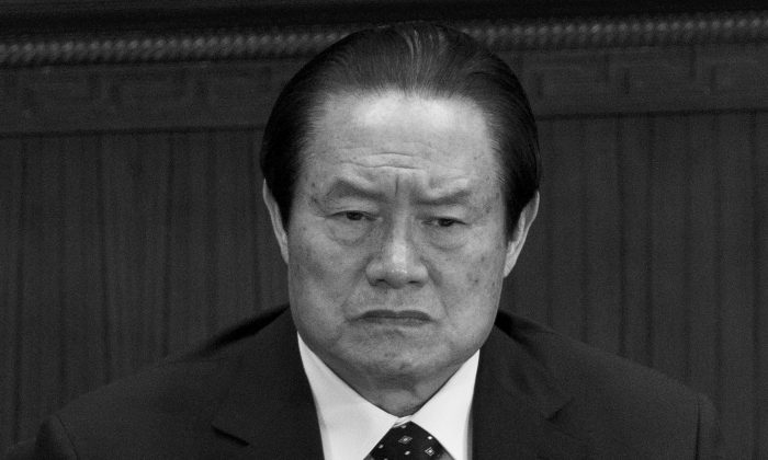 In this March 11, 2012, file photo, Zhou Yongkang, then the Chinese regime's domestic security czar, attends the National People's Congress in Beijing. Hu Ping argues that not long after this, Zhou set in motion the journalist's investigation that resulted in the exposure of offshore accounts held by top Chinese leaders who are opposed to Zhou.(AP Photo/Andy Wong, File)