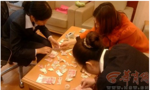 Chinese Boy Shreds Over 3,000 Yuan While Mother Cleans House