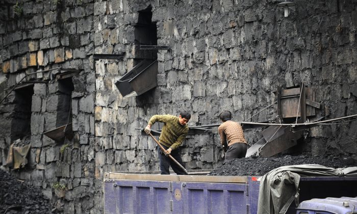 Chinese coal miners load coal into trucks in a mine in southwestern China's Sichuan Province, on Dec. 10, 2009. (AFP/Getty Images)