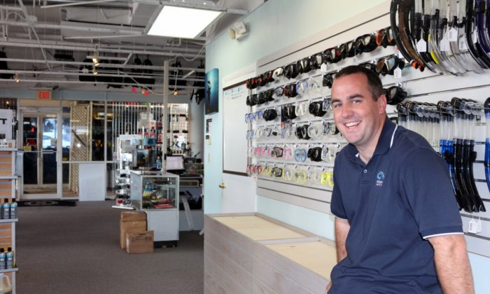 Bryan Armstrong, manager of the Pompano Dive Center in the store. He holds a masters in marine biology and shares his passion for diving with customers and dive students. (Myriam Moran copyright 2013)