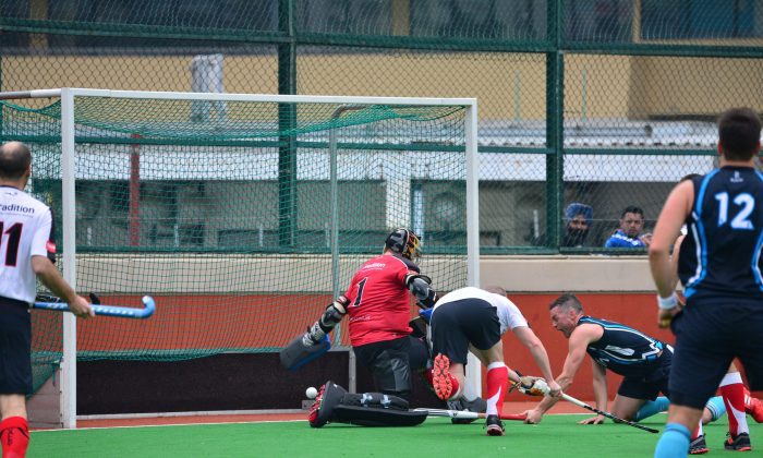 Great goal by HKFC-A attacker Rob Todd in their match Hong Kong Hockey Association Premier Division match at the Hong Kong Football Club ground against Valley-A on Sunday Jan 12, 2014. HKFC-A won the encounter 6-1. (Bill Cox/Epoch Times)