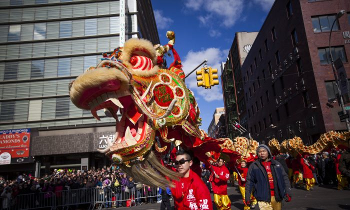 Dragon dancers cross Canal Street during the 14th Annual Chinatown Lunar New Year parade on February 17, 2013 in New York City. (Michael Nagle/Getty Images)