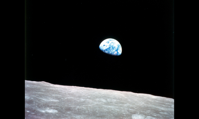 The Earth is seen from the moon on Dec. 24, 1968, in a photograph taken during the Apollo 8 mission. Private companies, as well as China and Russia, are now eyeing the moon as a resource for minerals. (NASA)