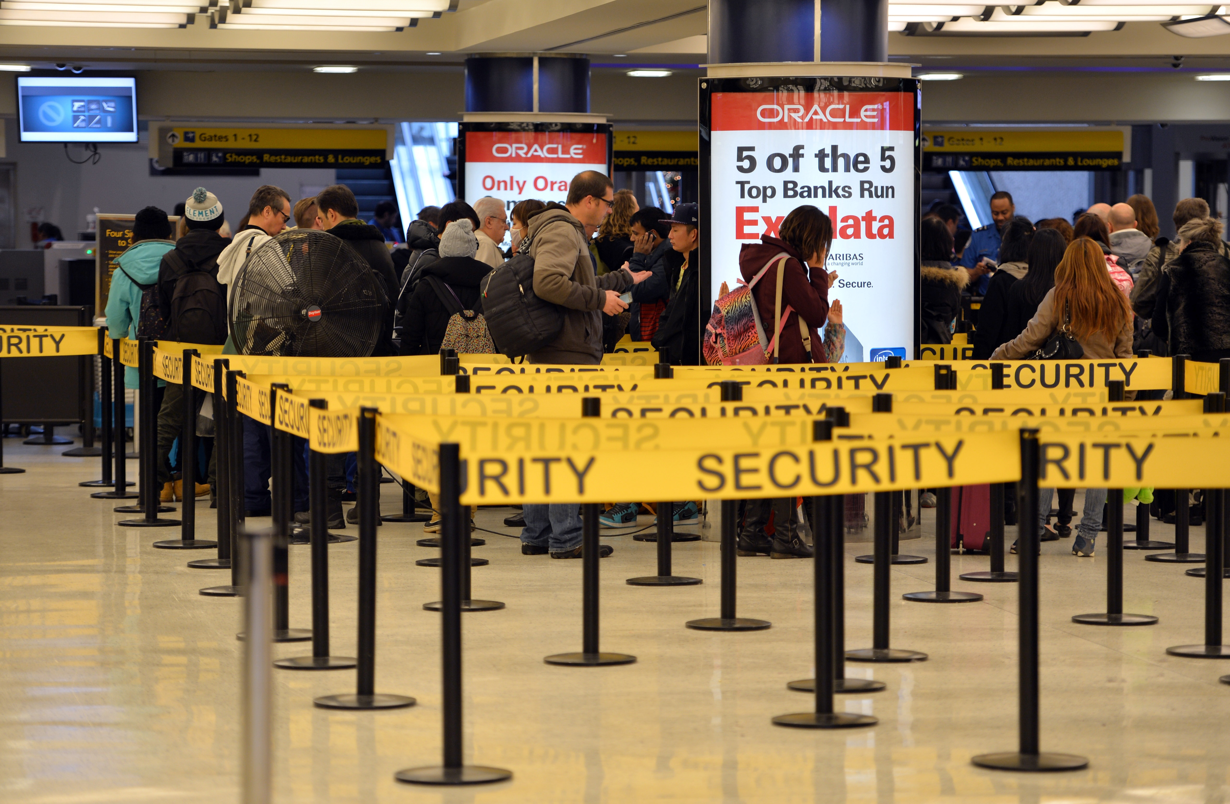 People wait in lines for security check-in at John F. Kennedy International Airport, New York, Jan. 6, 2014. (Stan Honda/Getty Images)