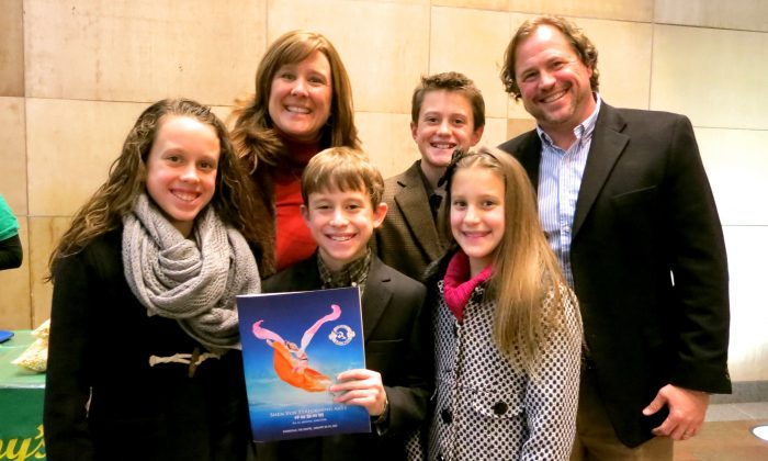 Eric Dodd with his wife and children enjoy an evening at Shen Yun Performing Arts at Evansville's Aiken Theatre at The Centre, on Jan. 29. (Stacy Tang/Epoch Times)