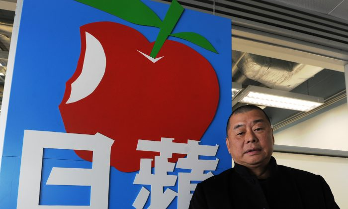 Jimmy Lai stands outside the headquarters of his Next Media company, on Feb. 7, 2011. (Mike Clarke/AFP/Getty Images)