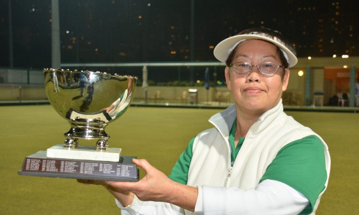 Hong Kong International Angela Chau proudly displays her fourth National Knock-out Singles trophy after defeating Candy Ng in the Final on Sunday Jan 19, 2014. (Stephanie Worth)