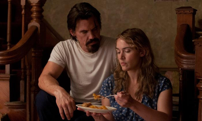 "Josh Brolin is Frank, an ex-convict, and Kate Winslet is his unwitting love interest in ""Labor Day,"" written for the screen and directed by Jason Reitman. (Paramount Pictures Corporation and Frank's Pie Company LLC)"