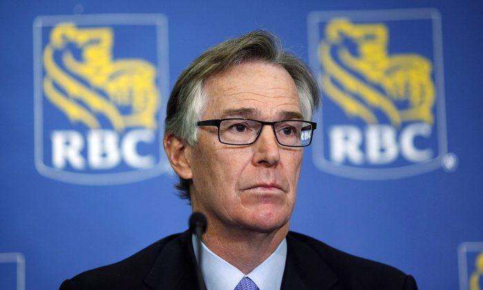 Royal Bank president and CEO Gord Nixon is shown in this file photo from Feb. 28, 2013. Nixon believes Canadian households will slow their demand for consumer loans. (The Canadian Press/Jeff McIntosh)