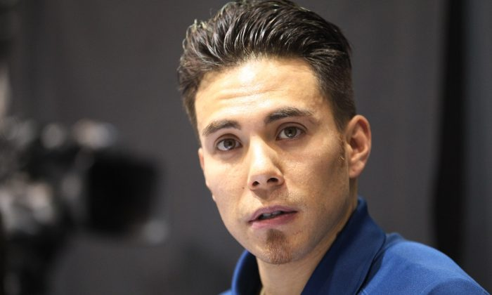 Apolo Anton Ohno is shown working from the broadcast booth before the women's 1,500 meters during the U.S. Olympic short track trials, Friday, Jan. 3, 2014, in Kearns, Utah. (AP Photo/Rick Bowmer)