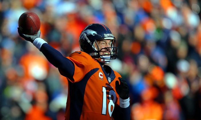 Peyton Manning #18 of the Denver Broncos looks to pass in the first quarter against the San Diego Chargers during the AFC Divisional Playoff Game at Sports Authority Field at Mile High on January 12, 2014 in Denver, Colorado. (Photo by Justin Edmonds/Getty Images)