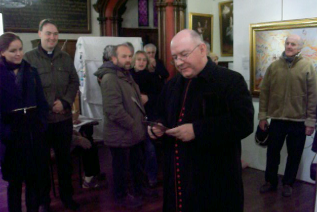 Rev Canon Leonard Doolan, Vicar of Cirencester, opening the Art of Zhen Shan Ren International Exhibition at the Town Hall, upstairs in the Church of St. John the Baptist.