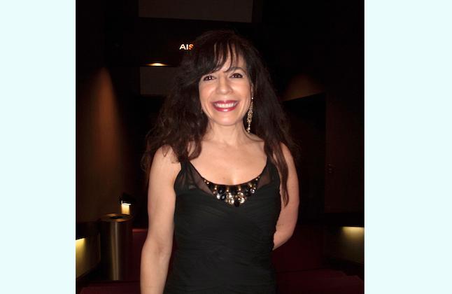Laury Robirosa enjoys Shen Yun Performing Arts at the Sacramento Community Center Theater, Jan. 14. (Alex Ma/Epoch Times)