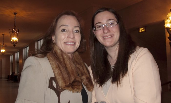 Anna Becky Redlich (L) and Franchesca Redlich admired the Shen Yun singers at the War Memorial Opera House Jan. 11. (Alex Ma/Epoch Times)