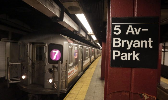 A No. 7 New York City subway train arrives in the 5th Avenue-Bryant Park Station, in Manhattan, New York, on Dec. 4, 2013. (AP Photo/Richard Drew)