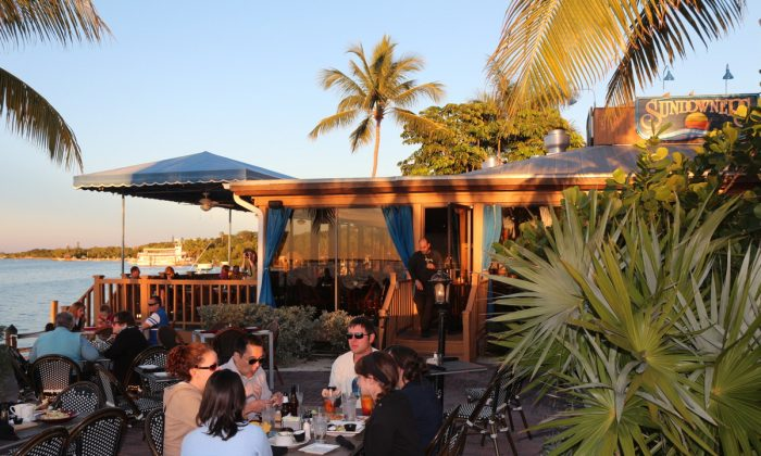 Sundowners patio overlooking the bay. Beautiful waterside vistas await divers at sunset. (Myriam Moran copyright 2014)