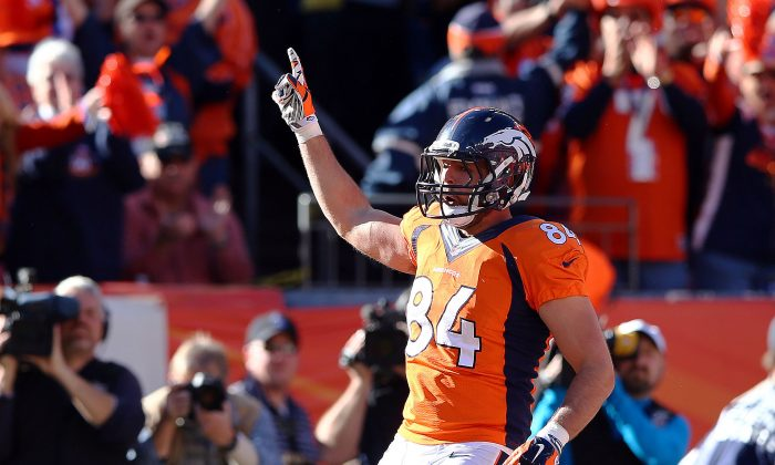 Jacob Tamme #84 of the Denver Broncos celebrates his second quarter touchdown against the New England Patriots during the AFC Championship game at Sports Authority Field at Mile High stadium in Denver, Colorado on January 19, 2014. (Elsa/Getty Images)