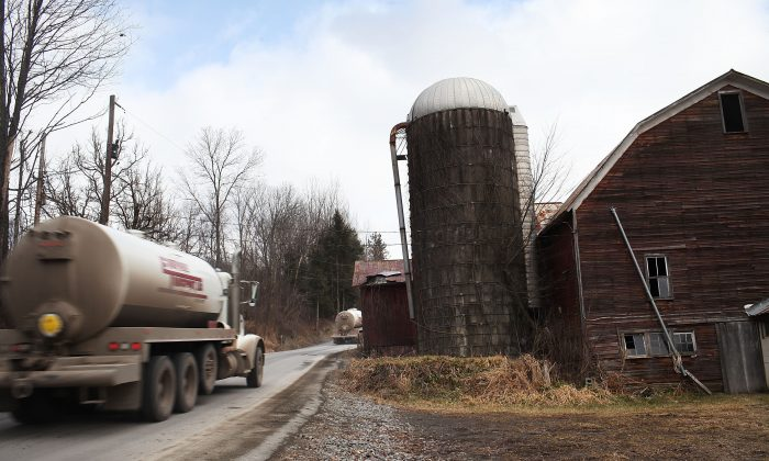 A truck with the natural gas industry drives through the countryside to a hydraulic fracturing site in Springville, Pa., Jan. 18, 2012. (Spencer Platt/Getty Images)