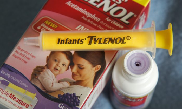 A container of grape-flavored Infants' Tylenol liquid medicine with the enclosed syringe and flow restrictor on Feb. 17, 2012. Sen. Chuck Schumer (D-N.Y.) wants children's liquid medicine bottles, like Infants' Tylenol, to be safer. (AP Photo/Amy Sancetta)