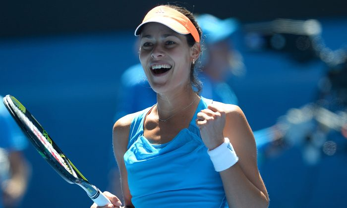 Ana Ivanovic celebrates after victory in her women's singles match against Serena Williams of the US on day seven of the 2014 Australian Open tennis tournament in Melbourne on January 19, 2014. (William West/AFP/Getty Images)
