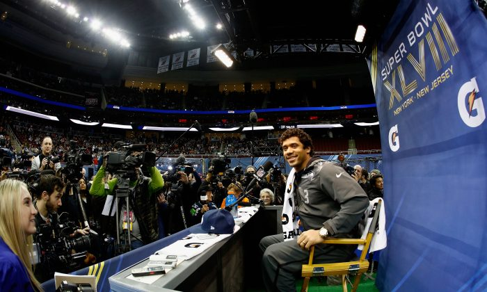 Seattle Seahawks quarterback Russell Wilson expressed his appreciation for Peyton Manning on Super Bowl Media Day at the Prudential Centre in Neward, New Jersey on Jan. 28, 2014. (Jeff Zelevansky/Getty Images)