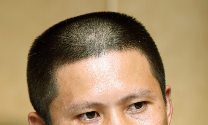 Legal scholar Xu Zhiyong on July 17, 2009. Xu is a prominent Chinese legal activist and the co-founder of a group promoting a civil society. He was sentenced to four years in prison. (AP Photo/Greg Baker, File)