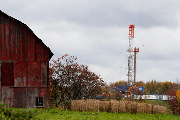 A drilling rig in Springville, Pa. Income from oil and gas production doesn't always trickle down to landowners, as companies find ways to minimize the share they pay in royalties. (AP Photo/ Alex Brandon)