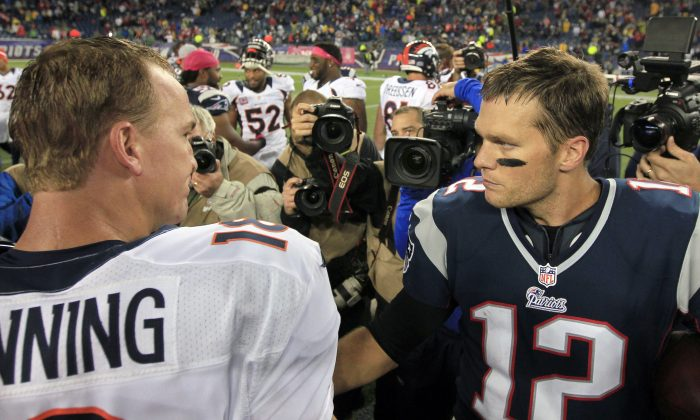In this Oct. 7, 2012, file photo, Denver Broncos quarterback Peyton Manning, left, and New England Patriots quarterback Tom Brady, right, speak in the middle of the field after the Patriots beat the Broncos 31-21 in an NFL football game in Foxborough, Mass. The Patriots are scheduled to play the Broncos in the AFC championship game on Sunday in Denver. (AP Photo/Steven Senne, File)