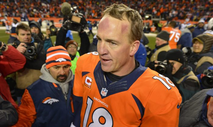 Denver Broncos quarterback Peyton Manning walks off the field after Denver beat the San Diego Chargers 24-17 in an NFL AFC division playoff football game, Sunday, Jan. 12, 2014, in Denver. (AP Photo/Jack Dempsey)